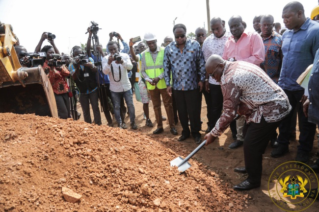 president akufo-addo inspects progress on motorway works; cuts sod for construction of tema town roads - akufo addo cutting sod - President Akufo-Addo Inspects Progress On Motorway Works; Cuts Sod For Construction Of Tema Town Roads